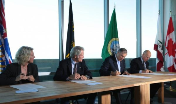 From left to right: British Columbia Environment Minister Mary Polak, Oregon Gov. John Kitzhaber, Washington Gov. Jay Inslee and California Gov. Jerry Brown signing a regional climate agreement last week.