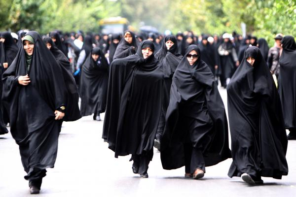 Iranian demonstrators march in Tehran in 2011, during a protest asking the government to intensify its enforcement of the Islamic dress code.
