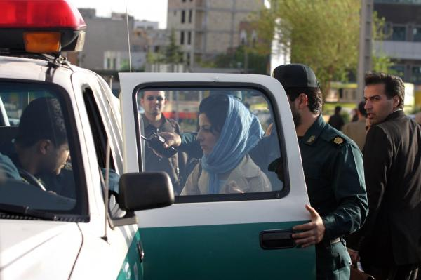 Police in Tehran detain a woman in 2007, for not adhering to the Islamic dress code.