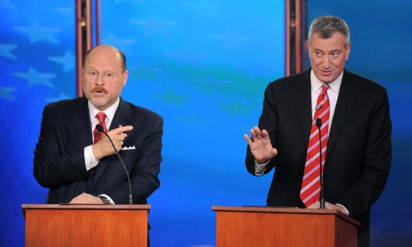 Joe Lhota, the Republican candidate for New York City Mayor, left, gestures toward his opponent, Democrat Bill de Blasio, as de Blasio holds his hand up in defense, during their final debate, Wednesday, Oct. 30, 2103 in New York. (Peter Foley/Wall Street Journal via AP)