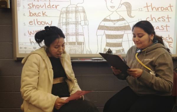 Students participate in a health literacy class at Mary's Center, role-playing a visit to the doctor. (Kavitha Cardoza/WAMU)