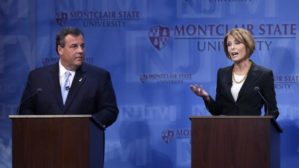 Republican Gov. Chris Christie listens as Democratic challenger Barbara Buono answers a question during a debate at Montclair University in Montclair, N.J., on Oct. 15.