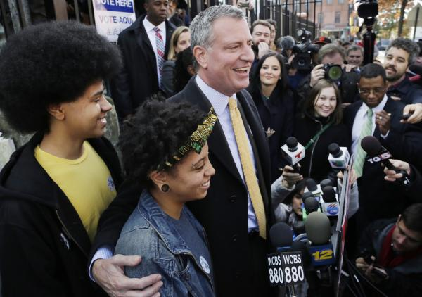 Democratic mayoral candidate Bill de Blasio with his daughter Chiara and son Dante as he talks to the media in Brooklyn after voting, Tuesday, Nov. 5, 2013.