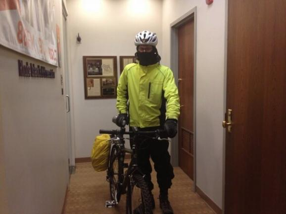 Rhode Island Public Radio's James Baumgartner prepares for a snowy ride during a blizzard last winter.