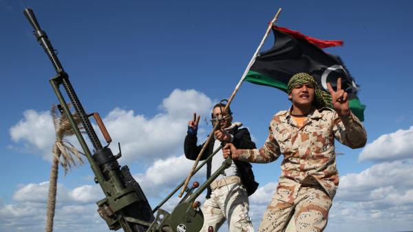 Militias from towns throughout the country's west parade through Tripoli, Libya, in 2012. Analysts say the country is awash with heavy weapons in the hands of militias divided by tribe, ideology and region. The central government has little power over the gunmen.