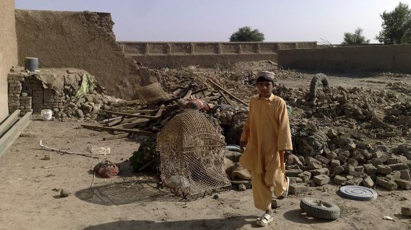 A boy stands at the site of a suspected U.S. drone attack in northwest Pakistan in 2008. Drone attacks and fighting in the region have resulted in post-traumatic stress disorder for many civilians, but few receive treatment.