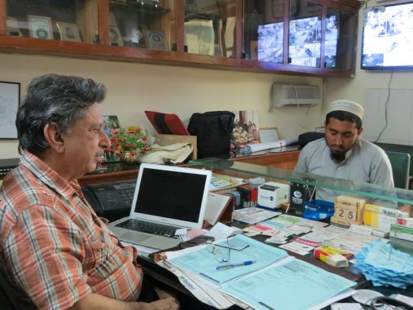 Dr. Khalid Mufti (left) speaks with Noor Khan, who is being treated for PTSD. Khan is a farmer in rural, northwestern Pakistan, where heavy fighting in recent years has caused many anxiety-related disorders among civilians.