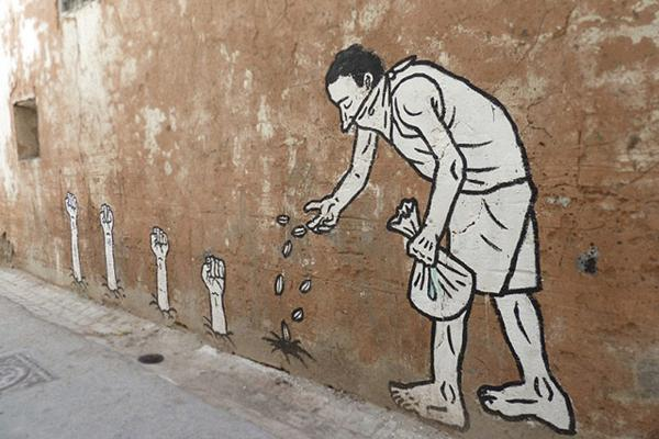 """The Sprouting of Revolutionary Fists,"" mural by Zoo Project in Tunis, Tunisia."