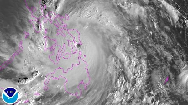 A still image from a NOAA satellite shows the progress of Super Typhoon Haiyan. The powerful storm, which had packed winds stronger than 200 mph while at sea, made landfall early Friday morning in the Philippines.