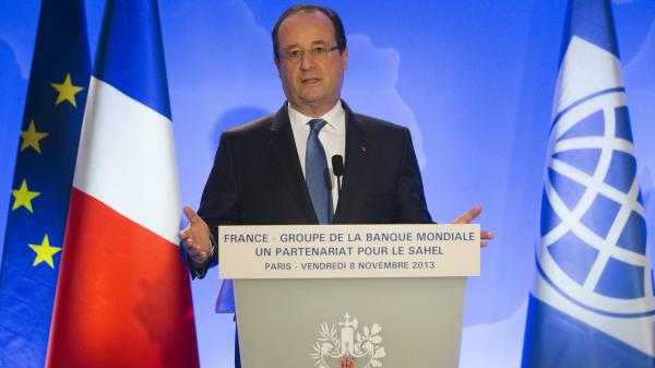 French President Francois Hollande speaks to the media at the World Bank Paris Office in Paris on Friday.