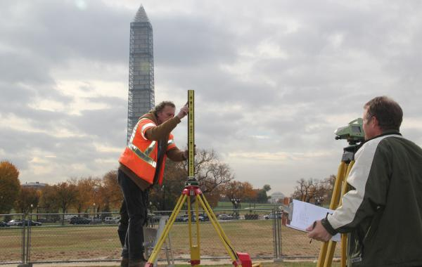 National Geodetic Survey crew members Roy Anderson, left, and Steve Breidenbach set up survey equipment used to measure the height of the Washington Monument.