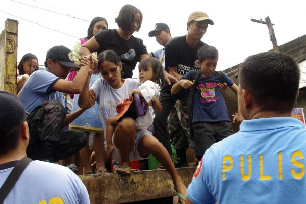 Those living near the slopes of Mayon volcano were evacuated to public schools by police in anticipation of the typhoon.