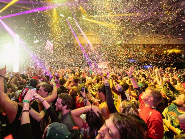 A crush of fans dance together at a Bassnectar performance, from the 2013 Mountain Oasis festival.