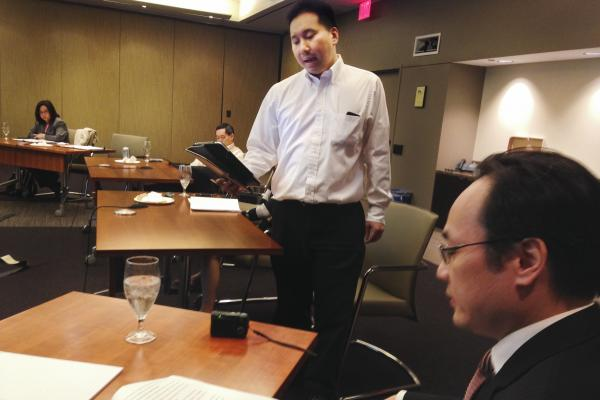 Attorney Francis Chin (center) runs through his lines with Yang Chen at a rehearsal for <em>22 Lewd Chinese Women</em>, the latest trial re-enactment by the Asian American Bar Association of New York.