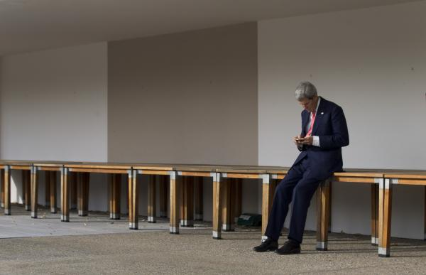 Secretary of State John Kerry checks his phone before a meeting with EU High Representative for Foreign Affairs Catherine Ashton and Iranian Foreign Minister Mohammad Javad Zarif in Geneva, Switzerland, on Saturday.