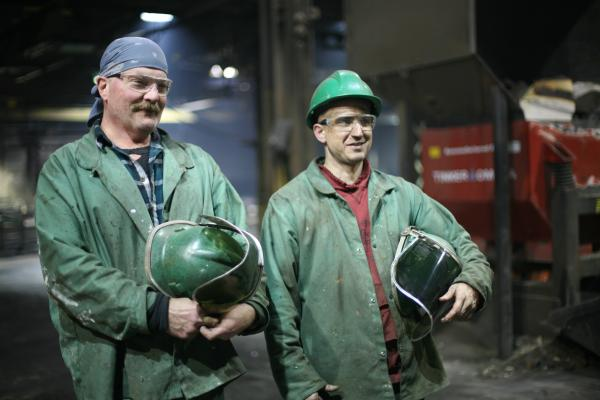 The whole process of pouring of the cast iron is the work of two men: Dan Hensley (left) and Ryan Houseman.