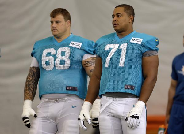 Miami Dolphins guard Richie Incognito (left) and tackle Jonathan Martin on the field during an NFL football practice in Davie, Fla., in July.