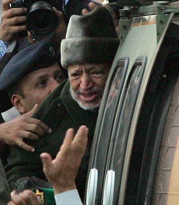 Palestinian leader Yasser Arafat boards a helicopter in Ramallah, the West Bank, for the start of his journey to a hospital in France on Oct. 29, 2004. He died 2 weeks later.