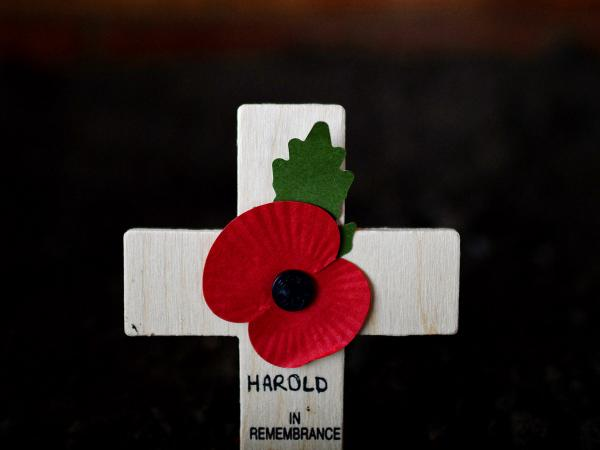 "A cross adorned with a poppy was among the ways Harold Percival was remembered Monday. Poppies have been a symbol of remembrance for veterans since <a href=""http://www.npr.org/blogs/thetwo-way/2011/11/11/142235639/we-pause-for-veterans-day-to-reread-in-flanders-fields"">the poem <em>In Flanders Fields</em> was written in 1915</a> by a Canadian military doctor."