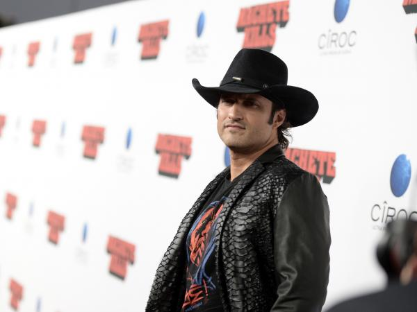 El Rey, which will be targeting a young Latino audience, is being spearheaded by filmmaker Robert Rodriguez, shown at the premiere of his recent film <em>Machete Kills</em> in October.