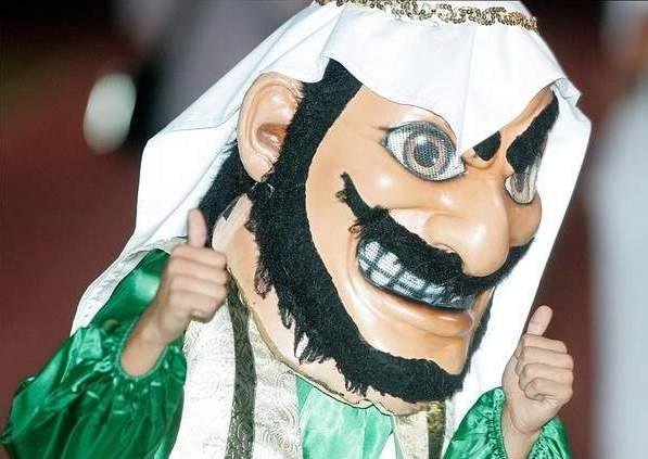 "The Coachella Valley High School mascot gives the thumbs up at a 2010 football game. Image courtesy of <a href=""http://www.mydesert.com/article/20131106/NEWS04/311060001/Coachella-Valley-High-School-Arabs-mascot-change-petition"">MyDesert.com</a>."