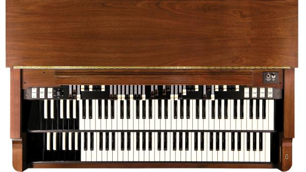 An overhead view of the modern Hammond B-3 organ shows two layers of keyboards and an array of drawbars and effects tablets.