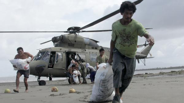 Survivors of Typhoon Haiyan in the central Philippines coastal village of Capiz got some help Monday when a Filipino military helicopter brought some much-needed food.