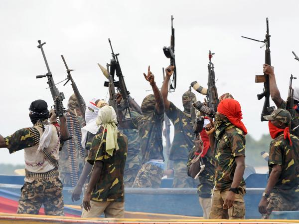 Fighters with the Movement for the Emancipation of the Niger Delta (MEND), pictured in 2008. The rebel group claimed responsibility for the kidnapping.