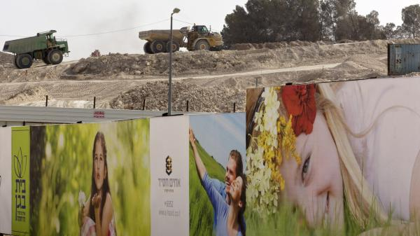Billboards advertise   apartments as construction takes place in the Har Homa section of Jerusalem. Israeli Prime Minister Benjamin Netanyahu has intervened after his housing minister announced plans for some 20,000 additional housing units in another sensitive area, known as E1, just east of Jerusalem in the West Bank.