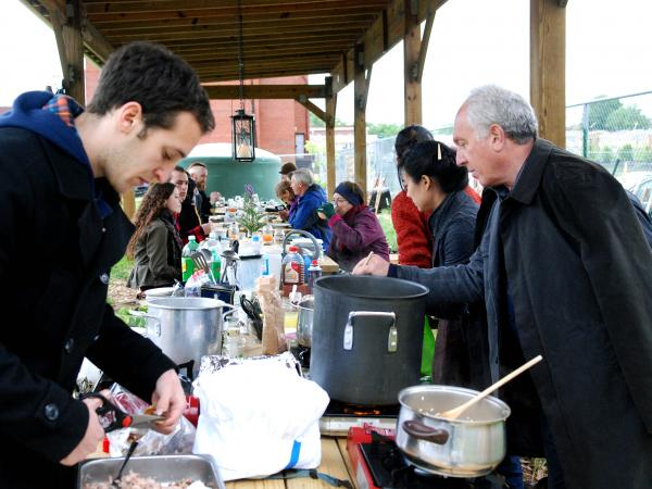 """Diners take part in the <a href=""""http://eatfeastly.com/meals/m/herbal-remedy-a-spring-picnic-adventure-on-the-far/"""">Herbal Remedy Picnic</a> event, a meal arranged through food sharing site Feastly, in Washington, D.C."""