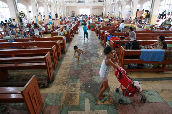 Residents take shelter at a church in Tacloban. On Wednesday, the Philippines' National Disaster Risk Reduction And Management Council estimated 600,000 people have been displaced because of the typhoon.