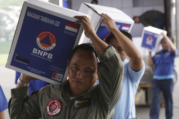 Indonesia air force personnel load relief supplies in Jakarta, donated for storm victims in the Philippines. Foreign governments and agencies have announced a major relief effort to help victims of the typhoon.