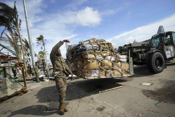 "A U.S. soldier helps unload relief goods at the airport in Tacloban. Marine Brig. Gen. Paul Kennedy said that U.S. military operations began 72 hours ago and ""moved 65 tons of humanitarian assistance supplies"" in that time. They plan to move the same amount Wednesday."