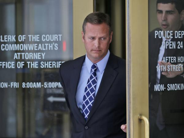 Lt. Col. Jeffrey Krusinski, who led the Air Force's Sexual Assault Prevention and Response unit, is seen leaving the Arlington County General District Court, in July.