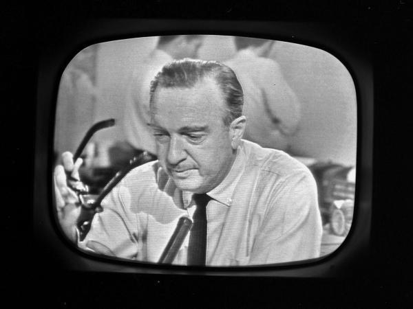 CBS newscaster Walter Cronkite announces the death of President John F. Kennedy.