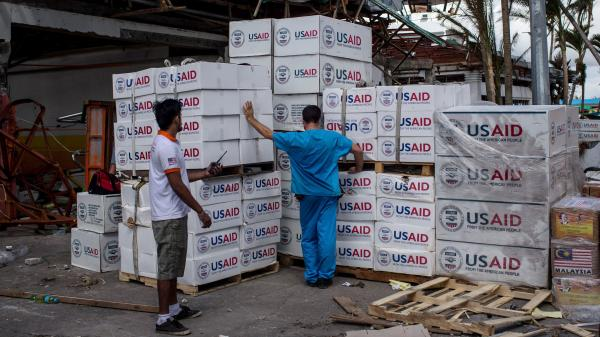 A relief worker looks over boxes of aid provided by the U.S. on November 14, 2013 in Leyte, Philippines. Proponents of food aid reform say it makes more sense for the U.S. to buy food donations locally than ship them across the globe.