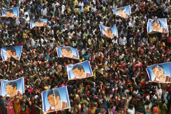 Indian schoolchildren display posters of Tendulkar as they gather to honor him in Chennai, India, on Nov. 14.