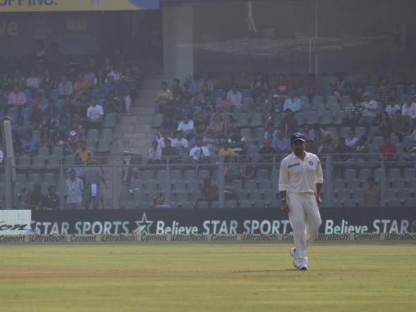 Sachin Tendulkar takes the field in his hometown of Mumbai on Thursday during his final cricket match playing for India.