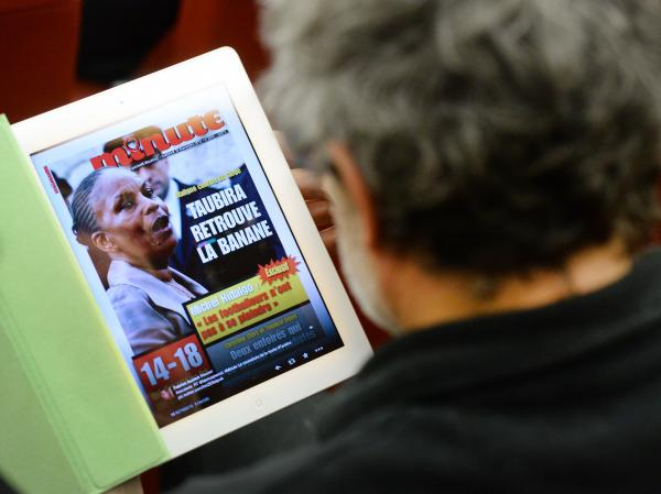 "The Nov. 13 issue of the French far-right weekly magazine <em>Minute</em>, with a picture of Justice Minister Christiane Taubira. Translated, the headline reads: ""Clever As A Monkey."""