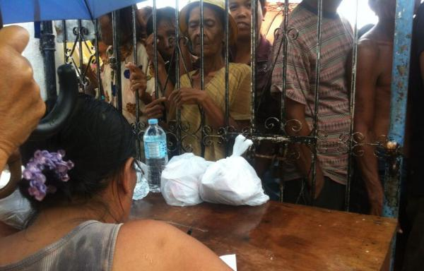 The BBC's Paul Moss tweeted this photo of hungry typhoon survivors waiting for food. (Paul Moss/Twitter)