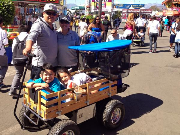 Brenda Lemus and her family tour the Los Angeles County Fair. They bought their wagon here, complete with canopy and storage space, six years ago.