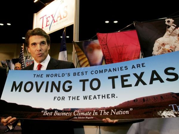 "Texas Gov. Rick Perry holds a sign promoting business in Texas, in San Antonio, on Nov. 8, 2004. Nearly a decade later, Perry is still touting the state's pro-business bent, including a <a href=""http://www.nytimes.com/2013/10/02/us/texas-governors-trips-to-lure-jobs-stir-skepticism-over-motive.html"">tour this summer</a> to several states."
