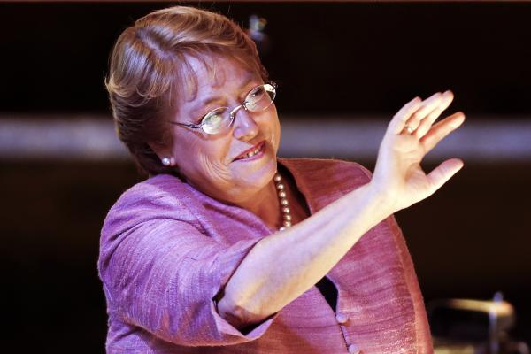 Former Chilean President Michelle Bachelet waves to supporters Sunday following general elections in Santiago, Chile.