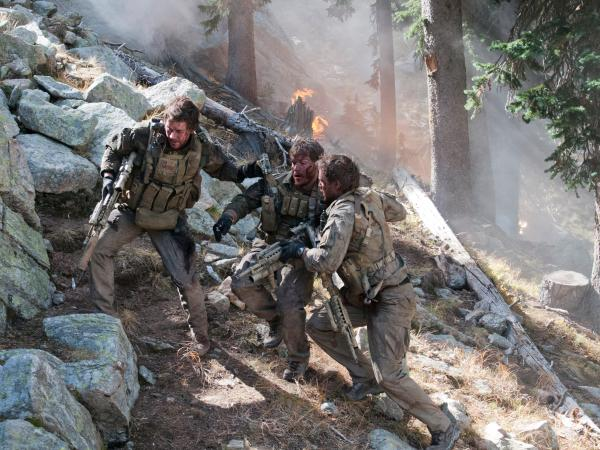 In <em>Lone Survivor</em>, Mark Wahlberg (left) stars as former Navy SEAL Marcus Luttrell, who was the lone survivor of a mission in Afghanistan in 2005.