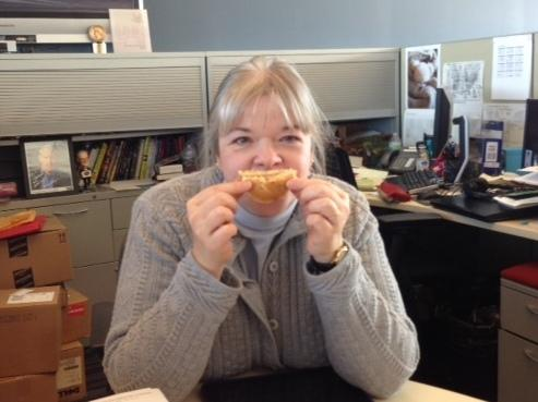 Lorna demonstrates the only way this sandwich will put a smile on your face.