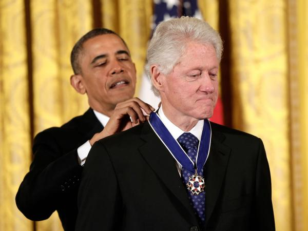 From one president to another: Former President Bill Clinton receives the Presidential Medal of Freedom from current President Obama.
