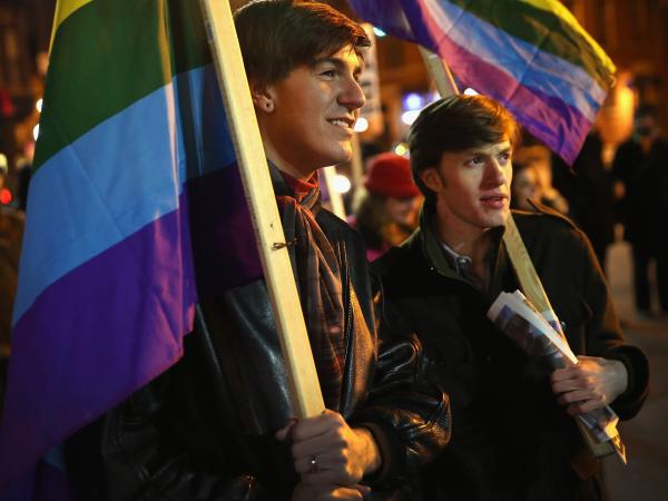 Nathaniel Iovinelli (left) and Ted Daisher join other supporters of same-sex marriage at a rally in Chicago to celebrate the Illinois General Assembly's passing of the gay marriage bill on Nov. 7.