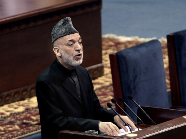 "Karzai told the gathering he supports a security deal with the U.S., but he didn't hide his troubled relationship with the Americans. ""They don't trust me, and I don't trust them,"" he said."