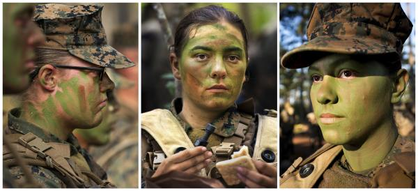 Pfcs. Katie Gorz (from left), Julia Carroll and Christina Fuentes Montenegro have become the first entry-level enlisted women to complete infantry training as part of the Marine Corps' effort toward integrating women into what have been all-male combat assignments.