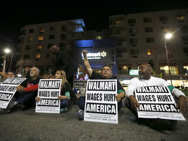 Dozens of people protest for better wages outside a Los Angeles Wal-Mart store on Nov. 7.